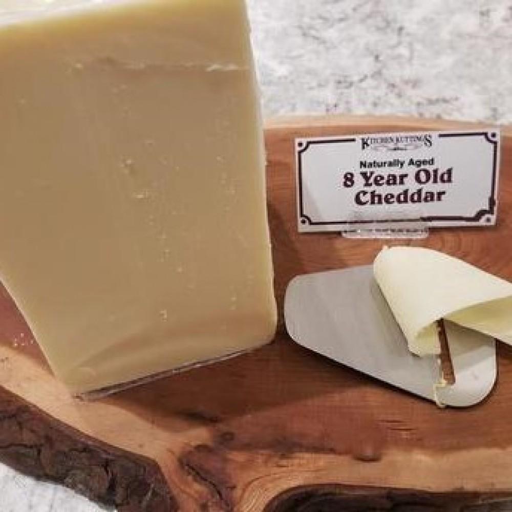 Fresh Cut 8 Year Old Cheddar (per 1/2 lb.)